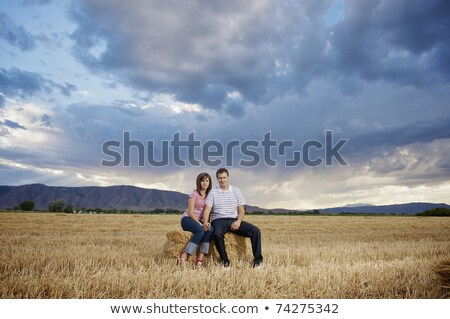man sitting on hay bale Stock photo © IS2