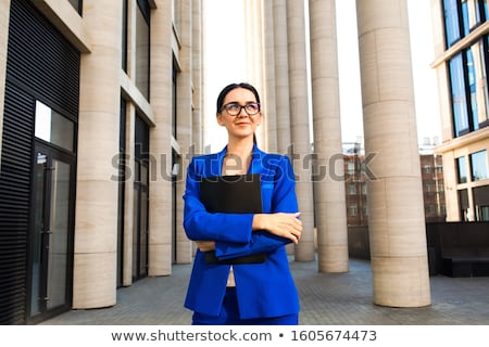Smiling woman looking away from camera Stock photo © IS2