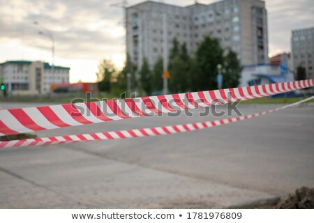 Red and white barrier tape in a pile on the ground Stock photo © Ashnomad