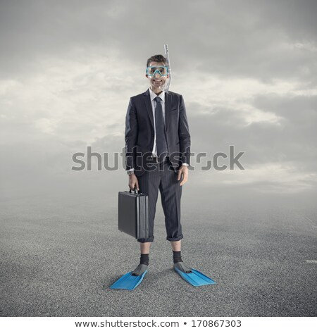 Man posing with diving mask and flippers Stock photo © wavebreak_media