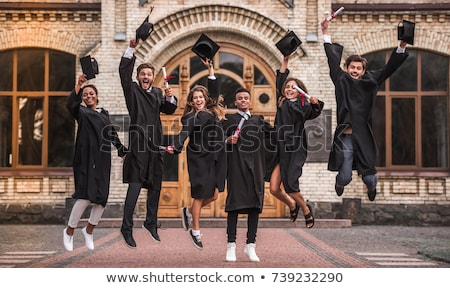 Graduates jumping Stock photo © IS2