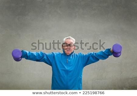 Idős férfi emel súlyok kint tornaterem Stock fotó © georgemuresan