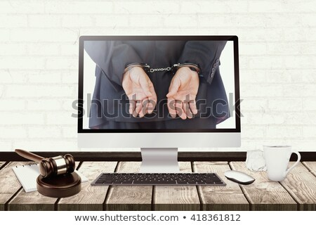 Laptop with with screen against wooden judges gavel Stock photo © wavebreak_media