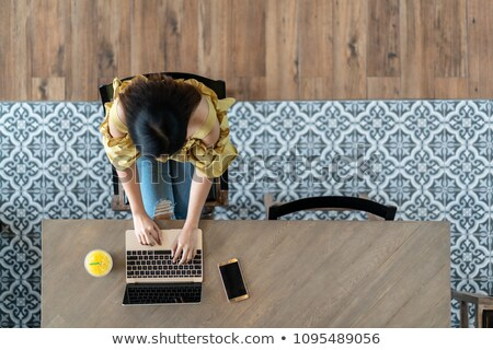 High angle view of woman using laptop in coffee shop Stock photo © wavebreak_media