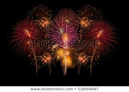 Heldere Rood Geel vuurwerk vakantie Stockfoto © TasiPas