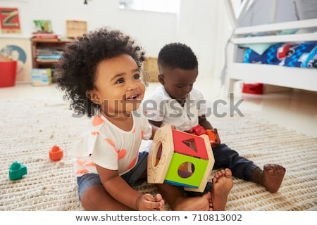 sitting toddler with a toy Stock photo © phbcz