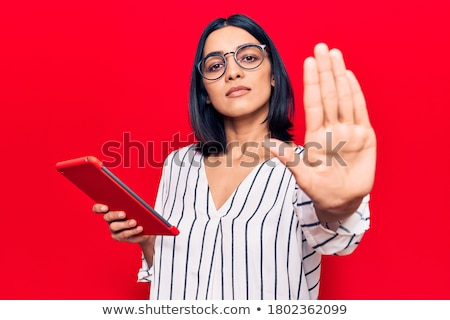 Female hand holding stop sign Stock photo © ra2studio