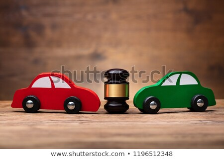 Wooden Mallet Between Two Cars Stock photo © AndreyPopov