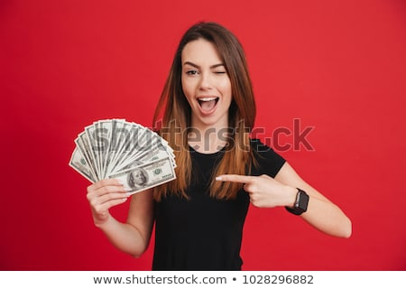 Portrait of an excited businesswoman showing money Stock photo © deandrobot