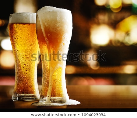 Smiling man with a mug of beer foam Stock photo © rogistok