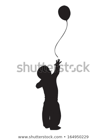 baby girl reaching to balloons at birthday party stock photo © dolgachov