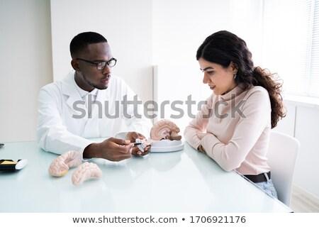 Médico detalhes cérebro humano mulher feliz Foto stock © AndreyPopov