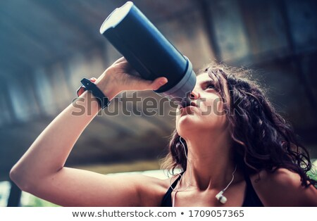 Young woman having exercise outdoors Stock photo © boggy
