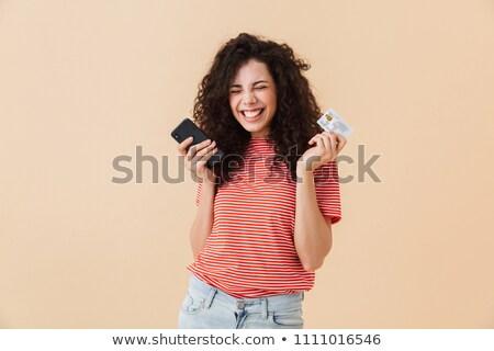 Kép izgatott nő 20-as évek göndör haj tart Stock fotó © deandrobot