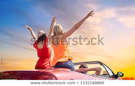 Stock photo: friends driving in convertible car over sky