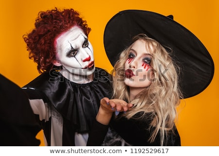 Pretty scary clown and wizard making selfie to camera isolated Stock photo © deandrobot