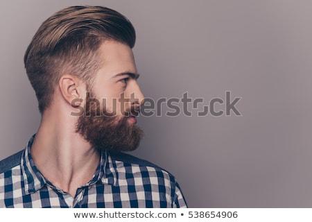Foto stock: Retrato · jovem · barbudo · homem · em · pé · isolado