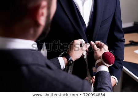 Tailor measuring customer with measuring tape Stock photo © Kzenon