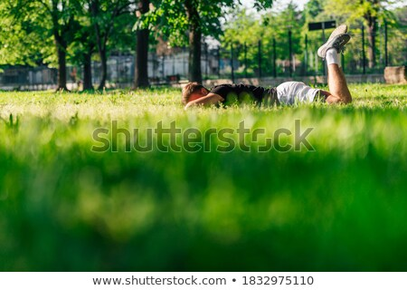 portrait of a tired sportsman resting stock photo © deandrobot