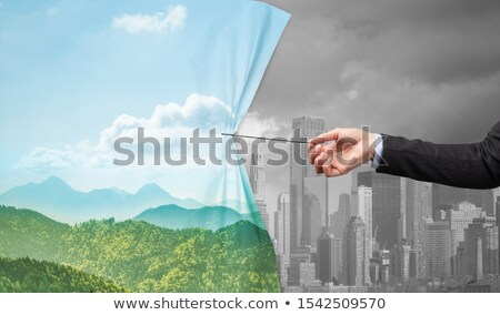 hand pulling green cityscape curtain to gray cityscape Zdjęcia stock © ra2studio