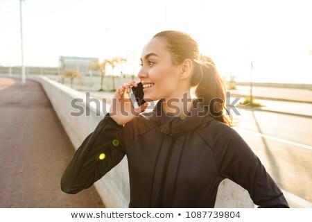 nő · város · park · beszél · telefon · szexi - stock fotó © deandrobot