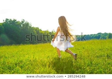 little · girl · corrida · grama · verde · belo · quente · verão - foto stock © ElenaBatkova