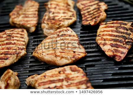 Grilled turkey meat. Steak turkey grill on on huge gas grill .  Stock photo © Illia