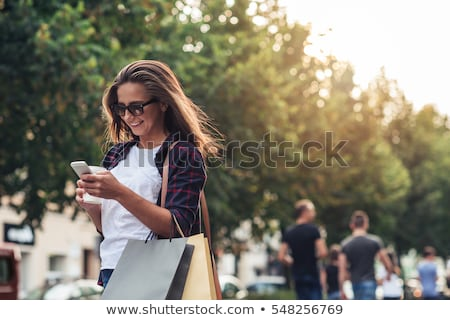 Stockfoto: Women With Smartphones And Shopping Bags In City