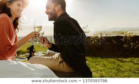 Iki mutlu kadın içme beyaz şarap konuşma Stok fotoğraf © dashapetrenko
