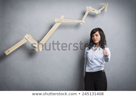 Pleased businesswoman holding thumbs up in front of ascending ch Stock photo © lichtmeister