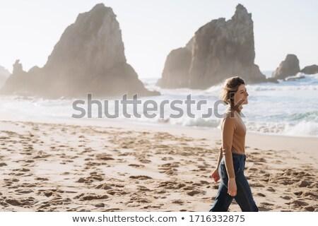 Vista laterale rilassante spiaggia donna Foto d'archivio © wavebreak_media