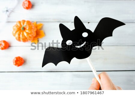 composition of dry leaves black paper bats small pumpkin and other stuff stock photo © pressmaster