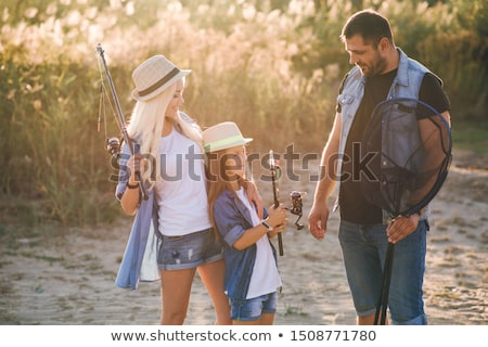 Fishermen go fishing with fishing rods in their hands Stock photo © galitskaya