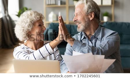 Mosolyog idős férfi otthoni pénzügyek számítógép férfiak Stock fotó © HighwayStarz