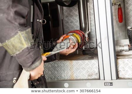 fire fighter connecting hoses stock photo © kzenon