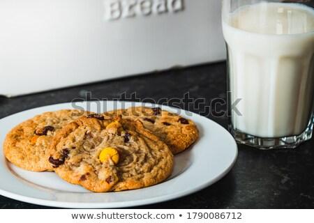 Fehér csokoládé keksz sütik kerámia tányér Stock fotó © DenisMArt