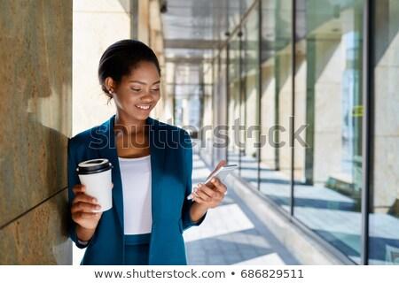 Kadın sokak iş takım elbise dizüstü bilgisayar eller Stok fotoğraf © ElenaBatkova