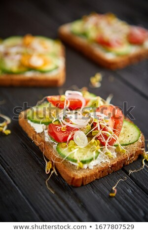 Healthy vege toasts with onion, cucomber, cherry tomatoes Stock photo © dash