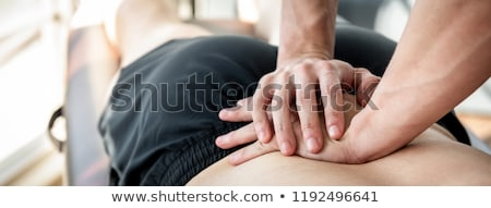 Doctor Giving Physio Massage To Patient Stock photo © AndreyPopov