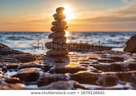 Equilibrio armonia ciottolo pietra spiaggia zen Foto d'archivio © dmitry_rukhlenko