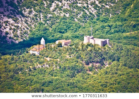 Historic Drivenik fortress and church on the hill in Vinodol val Stock photo © xbrchx