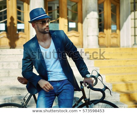 young man in hat and sunglasses poses Stock photo © Paha_L