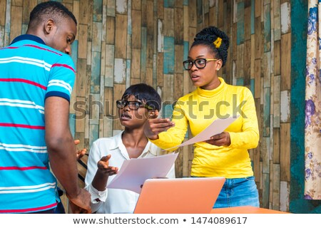 Man going through some work with a young female Stock photo © photography33