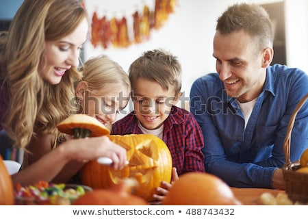 Stock photo: Mother and child carving pumpkins