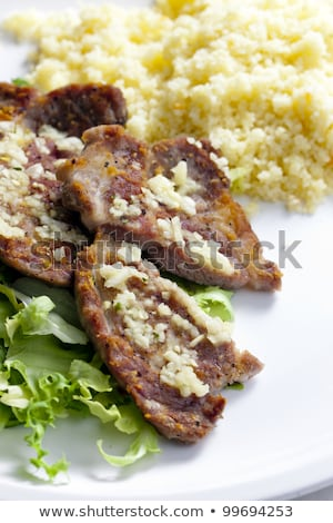 grilled pork neck on garlic with couscous Stock photo © phbcz