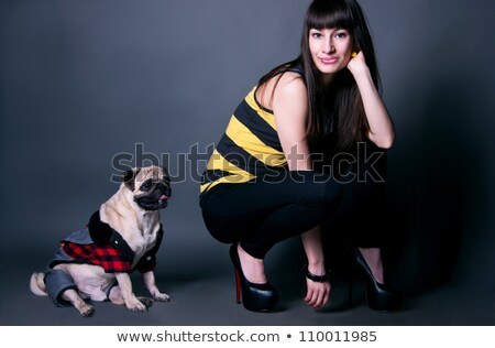 pretty sport girl with pug dog in studio stock photo © mariematata