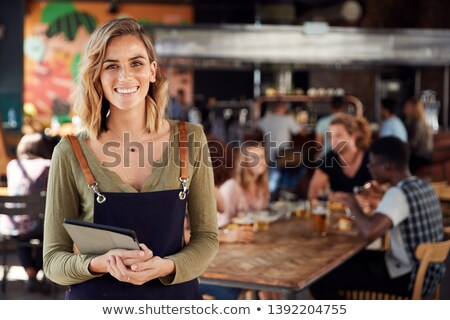 Waitress holding menu Stock photo © photography33