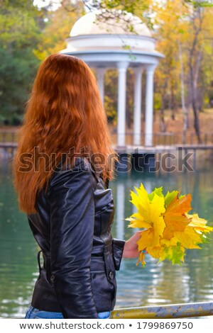 fit redhead standing in water stock photo © dolgachov