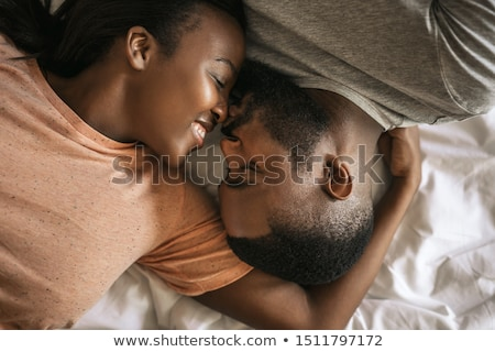 fiatal · pér · felfelé · reggel · kaukázusi · heteroszexuális · pár · ágy - stock fotó © ambro