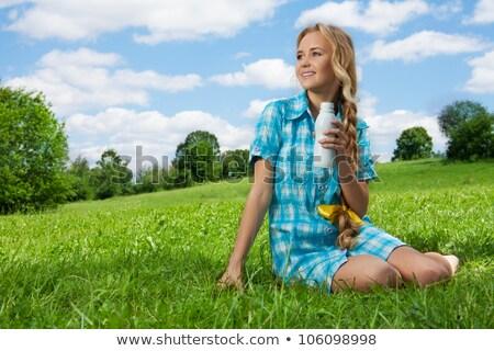 kobieta · posiedzenia · trawy · drzewo · ogród · piękna - zdjęcia stock © photography33
